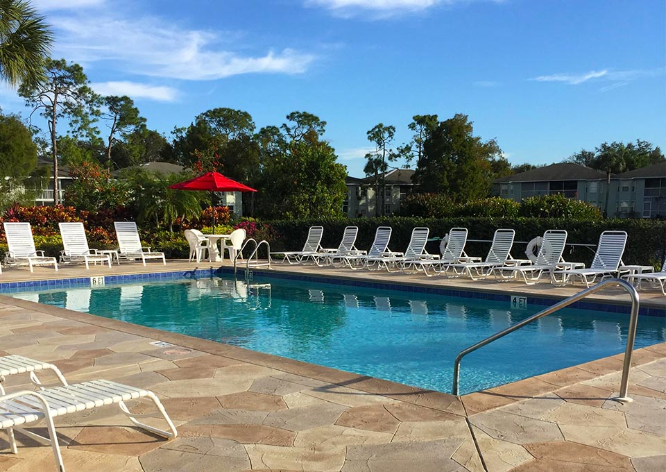 pool with lounge chairs and tables - New Waterford at Berkshire Lakes Condominium Association